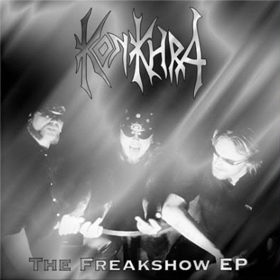 "THE FREAKSHOW  EP (1999) Recorded at Puk Recording Studios, Denmark, and Star-Struck Studio, Denmark – March 1999. Additional recordings at Sound Temple Studio, Oakland, CA. Produced by Vincent Wojno and Konkhra. Mixed by Vincent Wojno at The Plant, Sausalito, CA. Lead guitar performed by James Murphy. Released June 7th 1999. Taster for the album ""Come Down Cold"".    Line up: Anders Lundemark – Guitar + vocals. Per M. Jensen – Drums. Lars Schmidt – Bass.    Track list : 1. Sight For Sore Eyes 2. Truly Defiled 3. None Of These Days 4. Prowler (Iron Maiden) 5. Orgasmatron (Motorhead)"